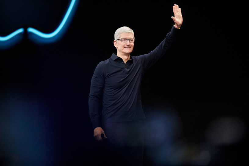 Tim Cook waving in a black shirt at WWDC conference