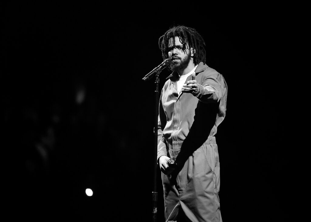 J cole in a black and white picture